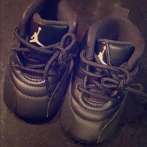 Jordan 12's all black size 2c
